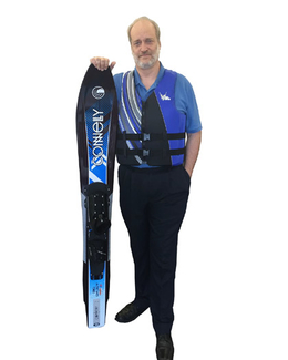 "6' 8"" tall customer holding a Connelly Big Daddy Ski and wearing a TALL life vest"